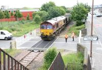 EWS 66078 brings coal empties from Cockenzie power station over Seafield level crossing on 9 June 2005 on their way to Leith Docks. View east from the pedestrian footbridge - note the smart new crossing gates!<br><br>[John Furnevel&nbsp;09/06/2005]
