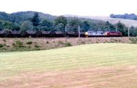 Down coal empties approaching Beattock station from the south in 1997, double headed by a pair of class 37s sporting EWS and BR Railfreight Metals sector liveries.<br><br>[John Furnevel&nbsp;//1997]