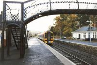Platform scene at Pitlochry in November 1999 as First ScotRail 158722 departs with a southbound service.<br><br>[John Furnevel&nbsp;02/11/1999]