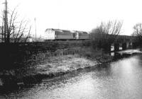A lengthy southbound freight crossing the River Caldew on the Carlisle goods lines on 8 December 1968, hauled by a pair of type 2 locomotives.<br><br>[John Furnevel&nbsp;08/12/1968]
