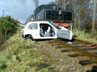 A graphic illustration of what can happen when you ignore the warning lights at an ungated level crossing. This is Dalfaber on the Strathspey Railway where, fortunately, only the car was written off. Photo credit David Gray.<br><br>[John Gray&nbsp;06/04/2005]