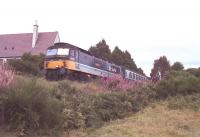 47 717 <i>Tayside Region</i> causes the sparks to fly with a heavy brake application on the approach to Aviemore, Summer 1990.<br><br>[John Gray&nbsp;//]