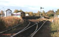 An Aberdeen - Inverness train held awaiting the crossing service alongside Forres East signal box in November 2005.<br><br>[John Furnevel&nbsp;04/11/2005]