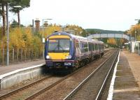 A Glasgow Queen Street - Inverness train pulls away from Carrbridge in November 2005.<br><br>[John Furnevel 01/11/2005]