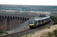 Southbound service passes over the Culloden Viaduct<br><br>[Ewan Crawford&nbsp;//2005]