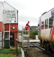 An Inverness service picks up the token for Forres at Elgin West Signalbox. This is the only operational signalbox in Elgin now and is the furthest north signalbox in the UK.<br><br>[Ewan Crawford&nbsp;//2005]