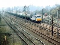 A 'Transrail' liveried class 56 with northbound oil empties passing Beattock in April 1999.<br><br>[John Furnevel&nbsp;05/04/1999]