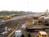 View west in 1972 over the area once occupied by a section of the extensive Portobello yard. A class 37 is approaching with a Granton - Grangemouth oil train on the main line while a type 2 is waiting for container loading to be completed in the Freightliner terminal. Part of the area to the left and rear of the camera is also in use as a PW depot.<br><br>[John Furnevel&nbsp;22/09/1972]