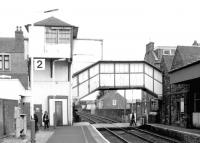Platform view east over the level crossing at Broughty Ferry station in August 1996, showing the unique signal box and integral footbridge. Note the doorway at the base of the box which originally gave access from the footbridge directly onto the platform. [See image 10571]<br><br>[John Furnevel&nbsp;04/08/1996]