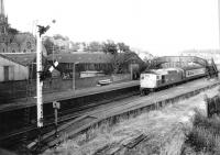 BRCW Type 2 26029 with a southbound service at Broughty Ferry in August 1982. The train is standing alongside the abandoned bay platform at the west end of the station.<br><br>[John Furnevel&nbsp;25/08/1982]