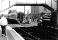 A southbound train entering Broughty Ferry station over the level crossing in 1996.<br><br>[John Furnevel&nbsp;04/08/1996]