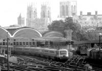 An ECML IC125 service leaving York for the south in the 1980s, with York Minster dominating the background.<br><br>[John Furnevel&nbsp;//]