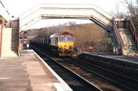 Longannet coal empties passing south through Cumbernauld station on their way back to Hunterston in February 2005 behind EWS 66102.<br><br>[John Furnevel&nbsp;26/02/2005]