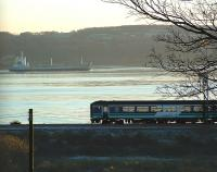 A West Highland Line train heading east from Cardross passes a ship sailing down the Clyde<br><br>[Beth Crawford&nbsp;18/11/2005]