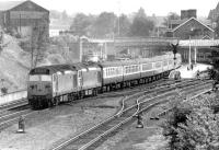 A pair of EE class 50 locomotives with train 1S57, the diverted down <I>Royal Scot</I>, heading north through Dumfries on Saturday 3 June 1972 during electrification work on the WCML. The large wooden sign on the old goods depot top left still reads <I>Caledonian Railway Goods Station</I>.<br><br>[John Furnevel&nbsp;03/06/1972]