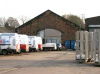 The only surviving building of what was a large Caledonian goods depot to the east of the current Dumfries station. This former goods shed, seen here in November 2005 being used by a firm of heating engineers, is hidden away in what is now St Mary's Industrial Estate.<br><br>[John Furnevel&nbsp;10/11/2005]