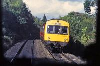The driver of a Dunblane-Edinburgh DMU waves to a colleague on a Glasgow-Dunblane working just north of Bridge of Allan station in October 1987. The photo was taken from the front of the latter train. Unusually for a service to Edinburgh, the approaching DMU is in orange/black SPTE livery.<br><br>[Mark Dufton&nbsp;/10/1987]
