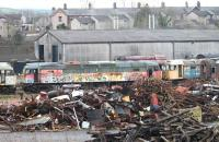 47776 stands among the scrap and other stored locos in the component recovery area at the West Coast Railways Carnforth Depot on 5 January 2015. The RES Brush 4, which has been here since 2007, is flanked by 47368 and 47526 with operational shunter 08418 just visible behind.<br><br>[Mark Bartlett&nbsp;05/01/2015]