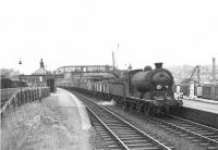 J37 0-6-0 64594 passing through Airdrie with an eastbound coal train on 26 August 1958.  <br><br>[G H Robin collection by courtesy of the Mitchell Library, Glasgow&nbsp;26/08/1958]
