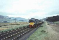 The up <I>Royal Scot</I> photographed shortly after passing Wandel Mill signal box just north of Abington on 26 September 1964 behind an EE Type 4 locomotive.  <br><br>[John Robin&nbsp;26/09/1964]