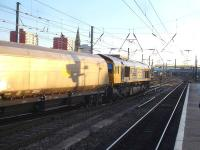 GBRf 66740 crosses from the up through line to the down side as it runs south through Doncaster Station on 13 January with a mixed rake of empty GBRf and former Fastline coal wagons.<br><br>[David Pesterfield&nbsp;13/01/2015]