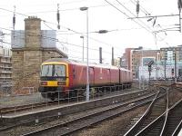 Royal Mail EMU 325015 runs to the stop block on the stabling siding at the west end of Newcastle Central station shortly after mid-day on 13 January 2015.<br><br>[David Pesterfield&nbsp;13/01/2015]