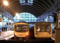 Why the long face? The TransPennine 185 on the left - about to depart for Liverpool makes the Northern 142 on the right look rather frumpy at Newcastle Central in December 2014. But 30 years' service by the latter puts most road vehicles to shame.<br><br>[Ken Strachan&nbsp;20/12/2014]