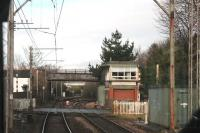 Deansgate Junction signal box, as seen from a Manchester bound tram. The box controls trains and trams between here and Altrincham including frequent movements over the level crossings here and at Navigation Road. The line to Stockport and Chinley can be seen curving right just beyond the box, which was extended when Metrolink opened but is scheduled to close in 2019. <br><br>[Mark Bartlett&nbsp;13/01/2015]