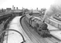 A busy scene looking north over Rutherglen station on 4 August 1955. A Maryhill - Hamilton train  is about to restart, hauled by Hamilton West's Fairburn 2-6-4T no 42167.<br>    <br><br>[G H Robin collection by courtesy of the Mitchell Library, Glasgow&nbsp;04/08/1955]