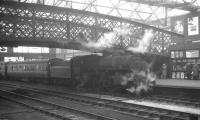 Ivatt 4MT 2-6-0 no 43000 adds to the atmostphere around the footbridge at Carlisle on 11 April 1964, after arriving with the Saturday morning 10.48am train from Langholm.<br><br>[K A Gray&nbsp;11/04/1964]
