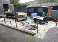 A fascinating collection of narrow gauge items at this clay mining museum near St Austell in 2014. There is even a solid tyred lorry - about 100 years old - in the shed in the background. Note the wagon turntable.<br><br>[Ken Strachan&nbsp;28/11/2014]