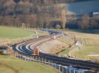 Reverse curves south of Stow on 19 January 2015, showing the limit of ballasting on the down line.<br><br>[Bill Roberton&nbsp;19/01/2015]