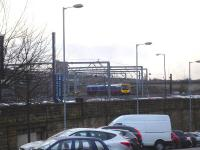 TransPennine 185144 about to turn onto the King Edward Bridge on 13 January after leaving bay platform 9 at Newcastle Central as the 1206 service to Liverpool Lime Street via Manchester Victoria.<br><br>[David Pesterfield&nbsp;13/01/2015]
