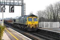 Freightliner 66527 with a ballast train, runs through Didcot station on 22 January 2015. Ultimate destination is the virtual quarry at Hinksey, just south of Oxford.<br><br>[Peter Todd 22/01/2015]