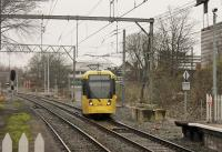 Nearly new Metrolink 3088, leaving the East Didsbury line, emerges from the <I>dive under</I> at Trafford Bar to join the Altrincham line into Manchester on 13 January. In BR days the two railways were not connected. With the opening of the Manchester Airport line Trafford Bar now has 20 trams per hour in each direction. <br><br>[Mark Bartlett&nbsp;13/01/2015]
