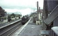 Station scene at Thankerton, South Lanarkshire, in September 1964, as Jubilee 45627 <I>Sierra Leone</I> passes through northbound with a Liverpool - Glasgow relief service. The 1848 station was finally closed to passengers four months later. <br><br>[John Robin&nbsp;26/09/1964]