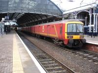 Royal Mail EMU 325015 stands at signals alongside platform 4 at Newcastle Central on 13 January 2015. The unit was returning to Tyne Yard following driver training along the north end of the East Coast route in advance of planned diversions during February. <br><br>[David Pesterfield&nbsp;13/01/2015]