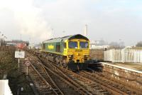 Freightliner 66516 about to passing through Didcot station from the Bristol direction with a container train on 22 January 2015. Note the recent changes to the Oxfordshire skyline [see image 44038].<br><br>[Peter Todd 22/01/2015]
