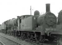 McIntosh 3F 0-6-0T 56336 in the sidings alongside Motherwell shed on 31 August 1963, with a sad looking Black 5 standing beyond. The 1910 Caley veteran had been withdrawn from 66B at the end of 1962.<br><br>[John Robin&nbsp;31/08/1963]