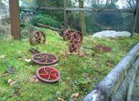 Oh dear, the rats have been at the timbers again. A collection of wheels for narrow gauge wagons [see image 50104] displayed informally at Wheal Martyn Museum. The timber structure in the background is a leat feeding an overshot water wheel, out of picture to the right.<br><br>[Ken Strachan&nbsp;28/11/2014]
