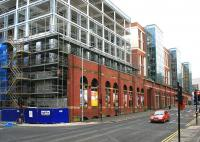The changing face of Glasgow. Looking west along Duke Street towards Glasgow city centre on 27 January 2015. The surviving facade of the former High Street goods depot has been incorporated within the new buildings that now line the route. [See image 28141]<br><br>[Colin McDonald&nbsp;27/01/2015]