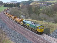 About a mile south of Stow, 66613 (leading) and 66614 take the ballast train south on 27 January.<br><br>[Bill Roberton&nbsp;27/01/2015]