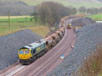 66613 and 66614 with the ballast train around a mile south of Stow on 27 January.<br><br>[Bill Roberton&nbsp;27/01/2015]