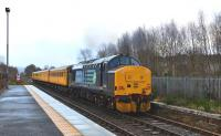 DRS 37425 is the motive power at the rear of the Network Rail test train departing Muir of Ord for Inverness on 28 January 2015. [See image 50166] <br><br>[John Gray&nbsp;28/01/2015]