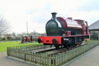 This Hudswell Clarke 0-6-0ST (1885/1955) has been cosmetically restored and is displayed at the entrance to the caravan site that is built on the Knott End line trackbed in Pilling. The loco has been named <I>Pilling Pig</I>, an unofficial name for all trains on the railway which originated with the 1875 loco <I>Farmer's Friend</I> which had a particularly squealing whistle. The number 11302 was actually carried by Manning Wardle 0-6-0ST <I>Knott End</I>, built in 1908 and scrapped by the LMS in 1925. <I>The Pilling Piglet</I> behind may be a representation of the ex-LNWR Railmotors that plied the line from 1923 to 1930. <br><br>[Mark Bartlett&nbsp;29/01/2015]