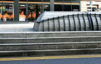 Little noticed by passing traffic and busy pedestrians, this inscription in the south face of the plinth covering the location of the former Glasgow Cross station is the only clue to the purpose of this rather odd feature in the middle of the Trongate at Glasgow Cross. [See image 50198]<br><br>[Colin McDonald&nbsp;31/01/2015]