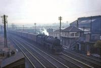 Perth based Black 5 no 45047 passing Stirling South signal box on a dull and misty February afternoon in 1965 with a train for Aberdeen. <br><br>[John Robin&nbsp;07/02/1965]