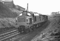 Late on the afternoon of 9 February 1970 and not far from journey's end at Millerhill Yard, EE Type 3 No D6903 negotiates the sharp reverse curves between Blackford Hill and Newington with the 13:22 partially fitted freight from Carlisle New Yard. Until just over a year earlier this train had been booked to run as an unfitted through train (8S50) over the Waverley Route, departing from Carlisle only a few minutes later, but train classifications had been altered in the interim.<br><br>[Bill Jamieson&nbsp;09/02/1970]