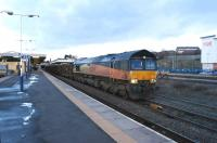 Colas 66849 <I>'Wylam Dilly'</I> passes Blackburn with the Carlisle New Yard to Chirk Kronospan log train on 31 January 2015.<br><br>[John McIntyre&nbsp;31/01/2015]