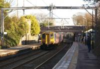 A Liverpool to Blackpool service runs non-stop through Thatto Heath station on 3 February 2015. Electrification is well advanced but there is a big push now on with full line possessions on Sundays until mid March in an attempt to recover from earlier delays.<br><br>[John McIntyre&nbsp;03/02/2015]